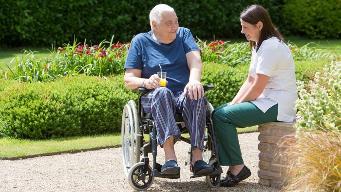 Occupational Therapist and Patient in Grounds chatting