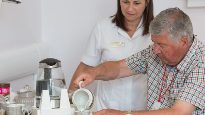 Rowcroft Hospice Occupational Therapist and Patient making a hot drink
